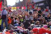 protestors stage a die-in outside the Labour Party Conference, 23 September 2006