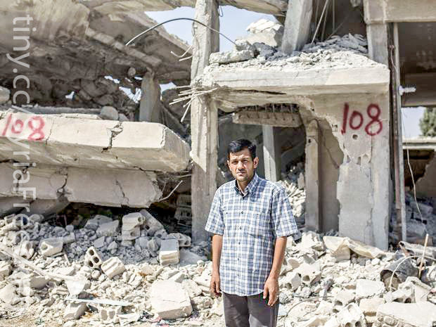 Abdullah Kurdi, afther of Aylan Kurdi, standing by his destroyed home