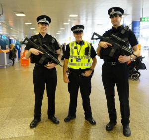 Armed police posing at Glasgow airport